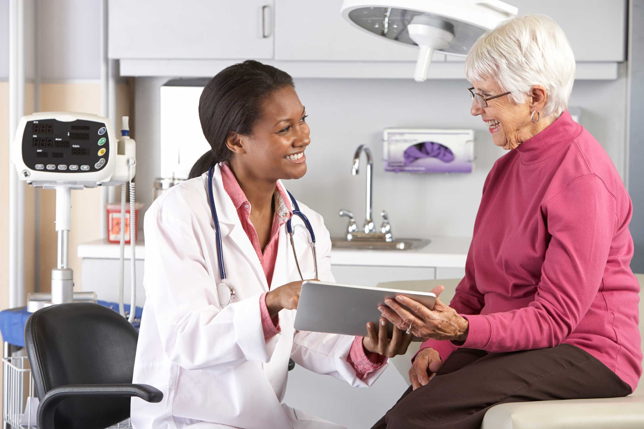 Doctor Smiling and Consulting with Senior Patient