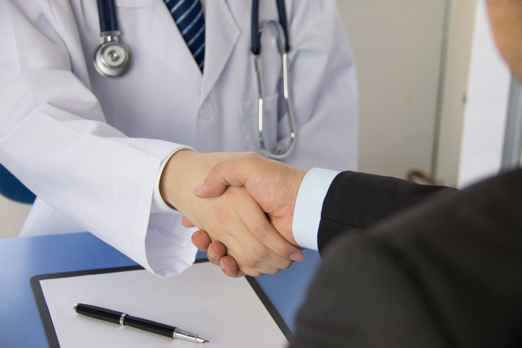 Doctor Shaking Hand with Professional