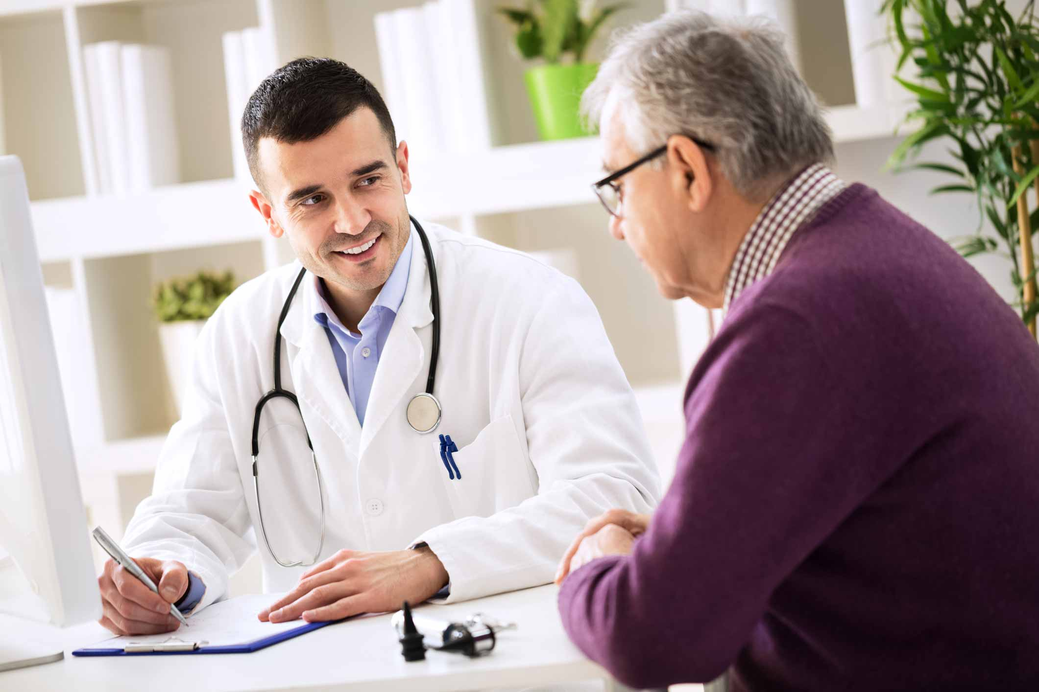 Doctor and Patient Consultation Sitting at Table